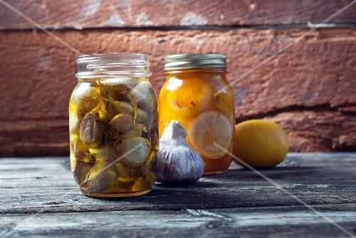Preserved garlic and lemons in mason jars