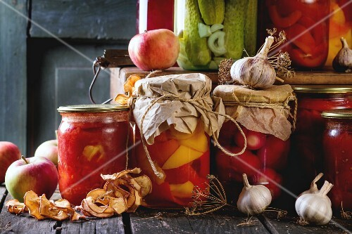 Homemade glass jars with preserved food (cucumbers, tomatoes, peppers)