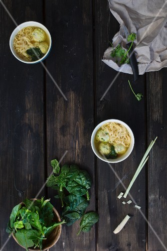 Noodle soup with spinach and dumplings