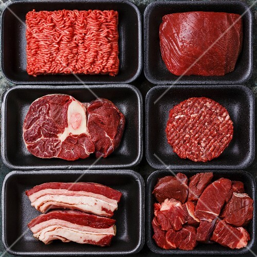 Different types of raw meat in plastic boxes packaging tray