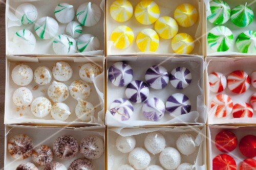 Small colourful meringue drops in boxes