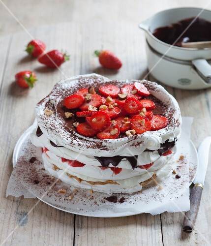 Meringue cake with strawberries, chocolate and nuts