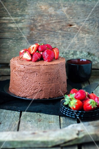A chocolate cake with strawberries
