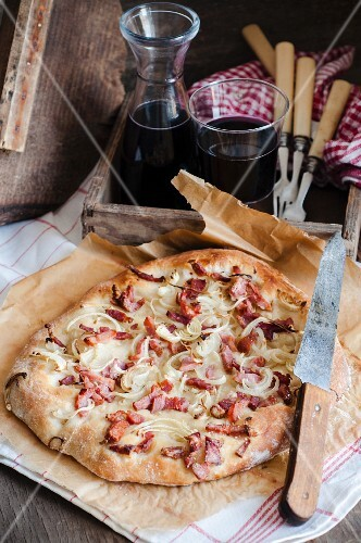 Rustic pizza with bacon and onion