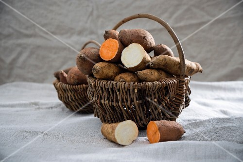 White and red sweet potatoes in a basket
