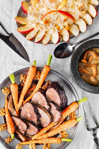 Beef roast with carrots and sauerkraut with apple