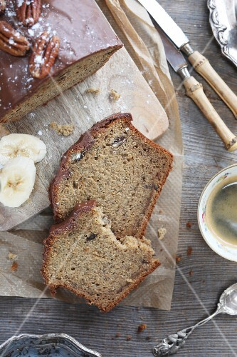 Vintage style banana bread with pecan and chocolate on top