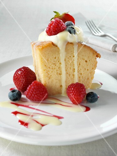 Spanish traditional sponge cake with evaporated and condensed milk topped with whipped cream and fruit