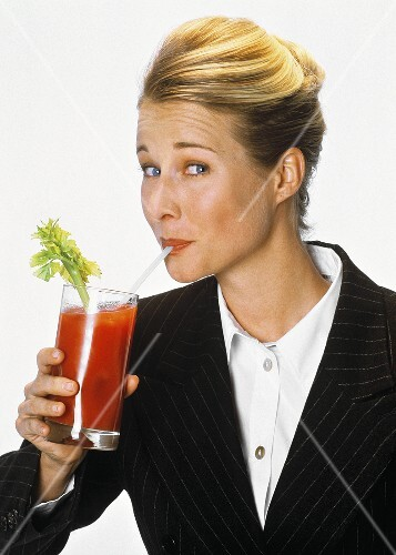 Woman Sipping a Bloody Mary