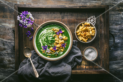 Nettle or Spinach Soup with Croutons and Edible Flowers