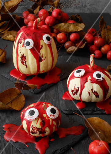 Halloween decorations made with ornamental squash and icing