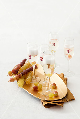 Champagne glasses and grape skewers