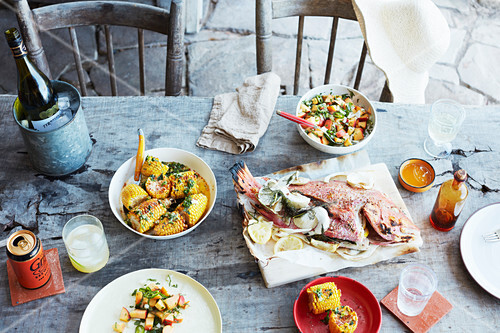 Whole Barbecued fish with chilli and peach salsa, Corn with herb butter and chipotle salt