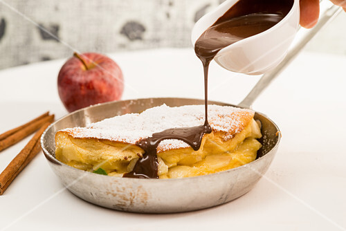 Yeast and apple omelette drizzled with chocolate sauce