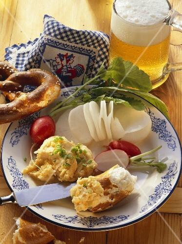 Bavarian snack: radish, cheese spread, pretzel & light beer