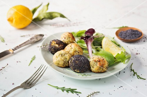 Vegetarian balls with fresh salad on the table