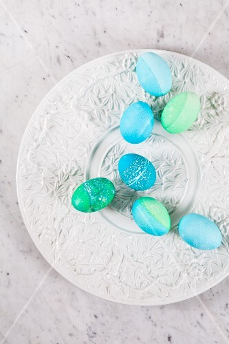 Dyed Easter eggs with batik patterns on a ceramic plate