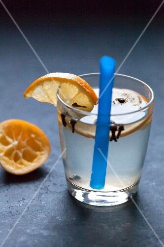 Lemonade in a glass with orange slices