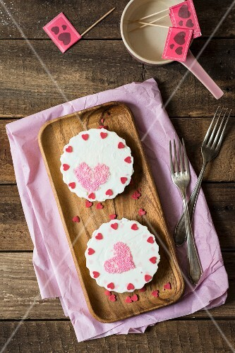 Yoghurt tartlets decorated with sugar hearts for Mother's Day