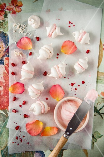 Mini meringues with rose water cream and pomegranate seeds (top view)