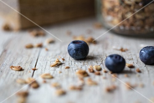 Cereal and blueberries on a wooden background