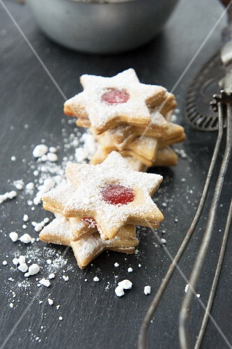 Star shaped jam cookies with icing sugar