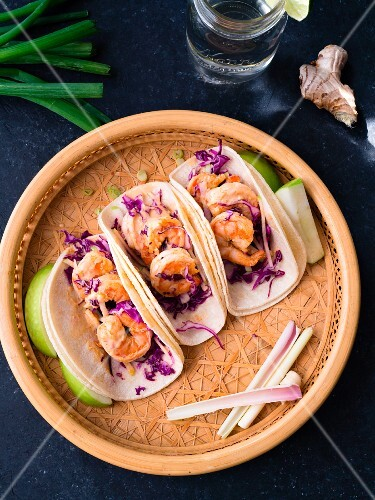 Asian flavored shrimp tacos with red cabbage and green apple slaw