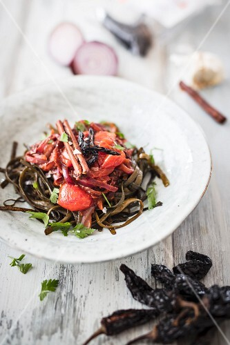 Vegan seaweed tagliatelle with tomatoes, onions, garlic, cinnamon and smoked chipotle chilli