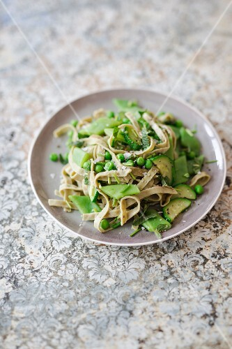 Edamame pasta with zucchini, beans, peas and fresh herbs