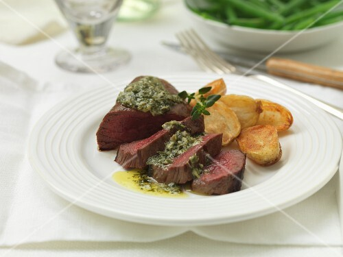Venison steak with salsa verde butter and fried potatoes