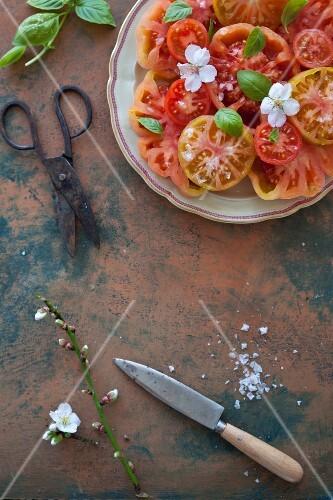 Tomato salad with sea salt flakes and basil