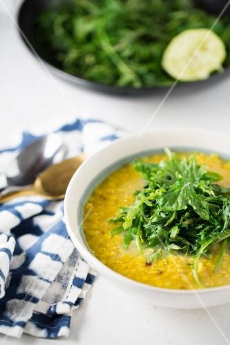 Red lentil soup garnished with rocket