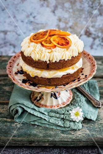 An orange pound cake with cream cheese and manuka honey