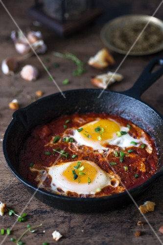 Shakshuka (poached eggs in tomato and pepper sauce, Middle East)