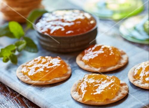Crackers with peach jam