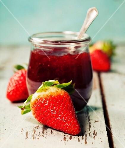 Homemade strawberry jam and fresh strawberries