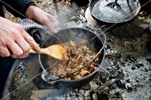 How to make a meat dish in a Dutch oven over a fire place