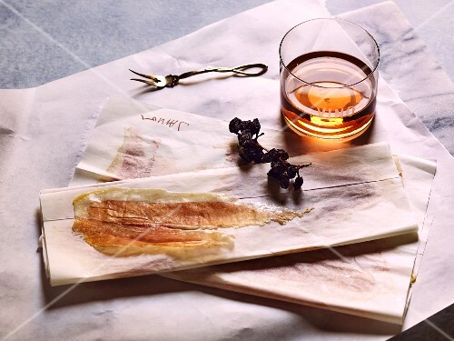 Spanish ham on parchment paper with a glass of sherry