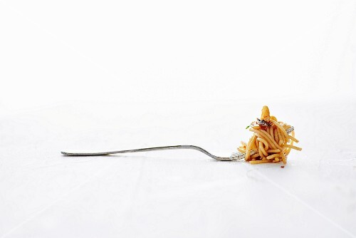 A Fork Full of Spicy Spaghetti Pasta With Anchovies and Garlic