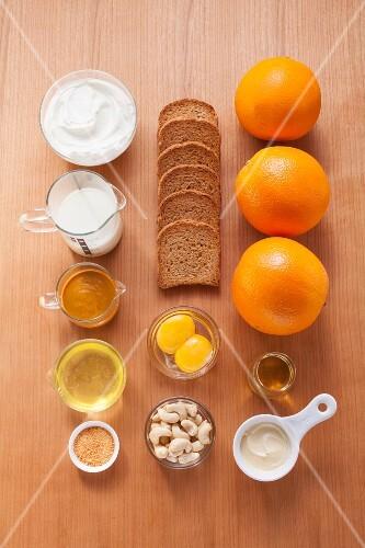Ingredients for quark cakes with orange sauce