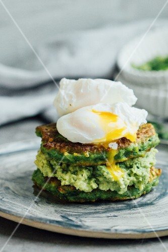 Pea pancakes with avocado puree and poached eggs