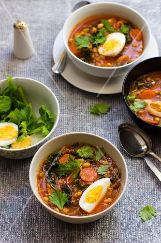White bean soup with harissa, honey, egg and celery leaves