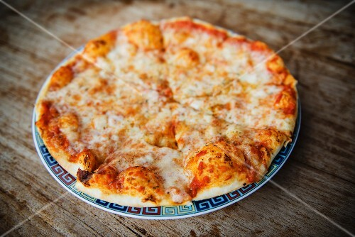 Pizza with cheese and tomatoes