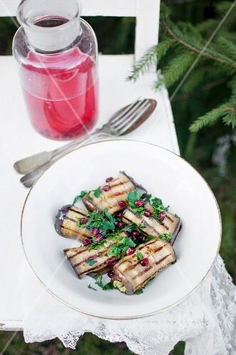 The Georgian dish 'Badrijani Nigvzit' (aubergine rolls stuffed with walnuts, parsley and garlic)