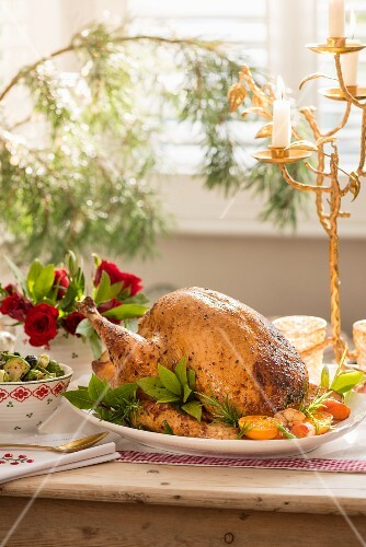 Roast turkey stuffed with vegetables, herbs and clementines