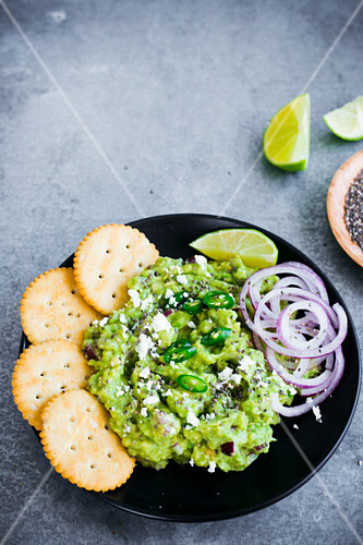Guacamole dip with chia seeds and fresh chilli peppers