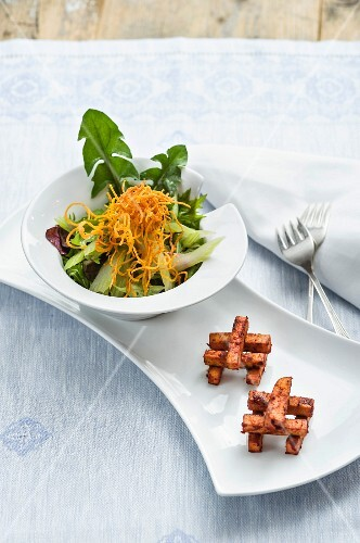 Celery and dandelion salad with fried tofu strips