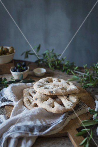Fougasse French bread on a rustic background