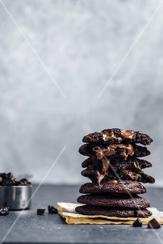 A stack of Mexican hot chocolate cookies, chocolate chips in the cookies are melting