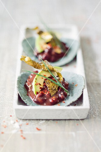 Blue tacos with bean chilli and algae bacon